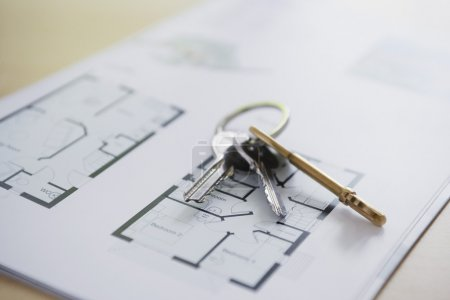 Keys lying on architectural blueprint