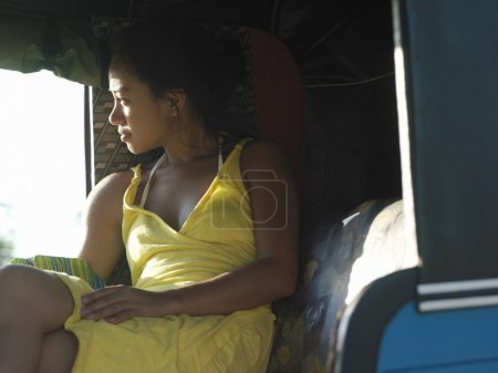 Young woman relaxing in car