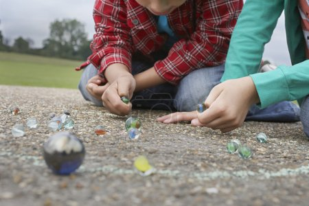 Boy and Girl Playing Marbles