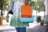 Teenage girl  carrying shopping bags