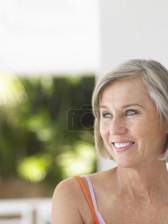 Woman standing on verandah