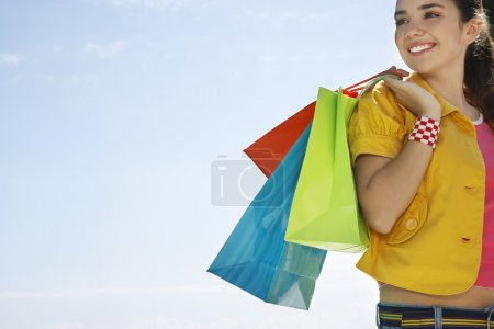 girl carrying shopping bags