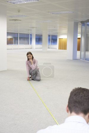 Man and Woman Measuring  Office