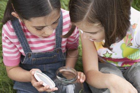 Girls looking in Jar