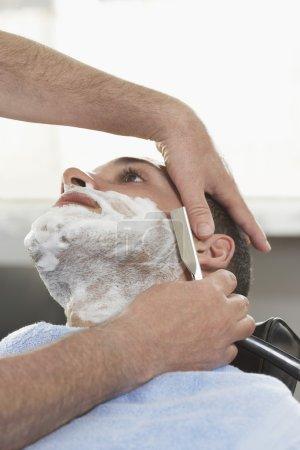 Barber shaving man