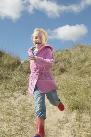 cheerful Girl on sand dunes