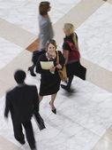 Business woman standing amongst people