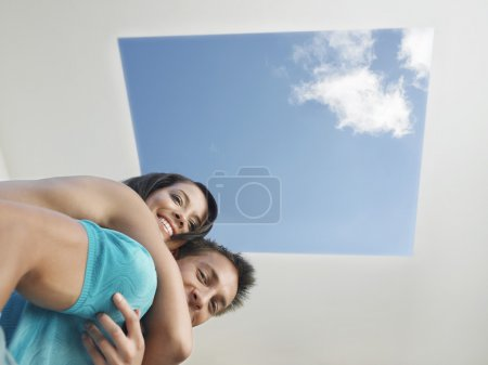 Couple hugging Under Skylight