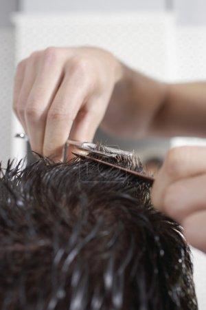 Barber cutting mans hair