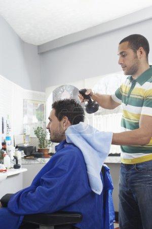 Barber preparing man