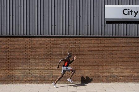 Athlete Sprinting on Sidewalk