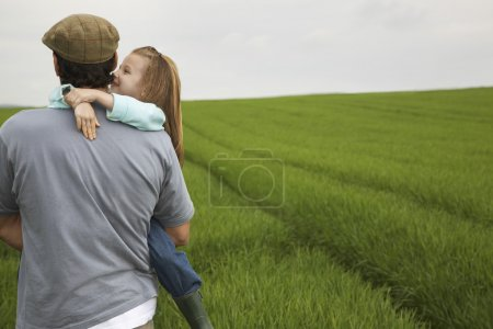 daughter  with Father  in field