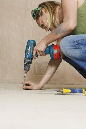 Woman Using Cordless Screwdriver