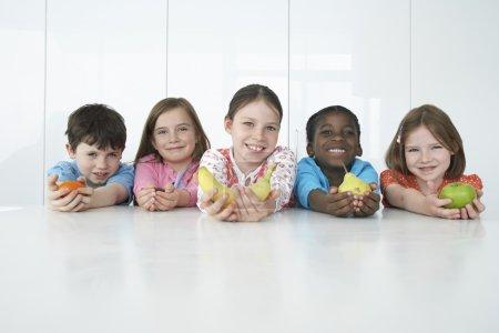 Children Holding Fruits