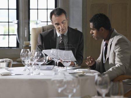 Business men analyzing documents