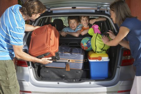 Family loading car trunk