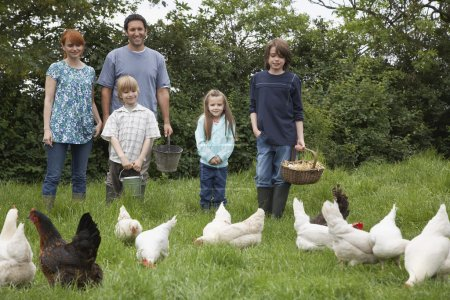Parents and children with hens