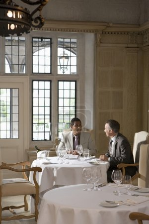 Business men sitting at restaurant