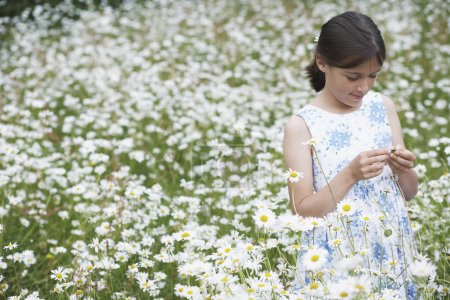 Photo for Girl in Wildflower Meadow - Royalty Free Image