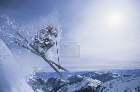 Person on skis jumping over slop