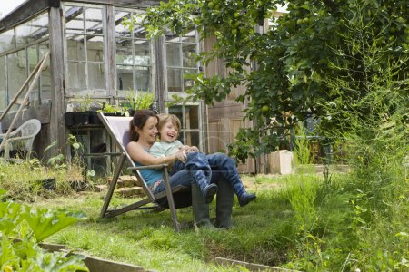 Mother  with son in garden