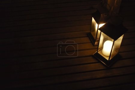 Photo for Two illuminated lanterns on deck at night - Royalty Free Image