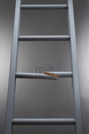 Photo for Ladder with one step broken - Royalty Free Image