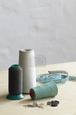 threads, pins and measuring tape