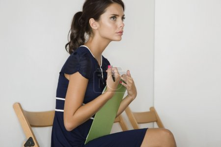 Woman before interview in waiting room