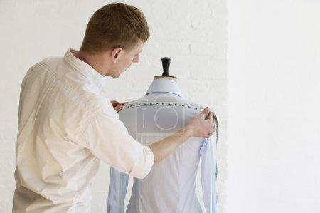 Tailor measuring blouse hanging