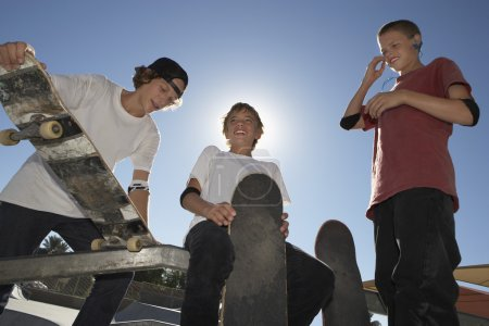 teenage boys with skateboards