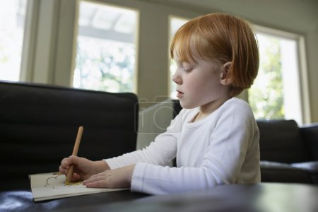 Girl drawing with crayon