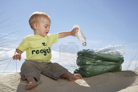 Boy playing with plastic bottles