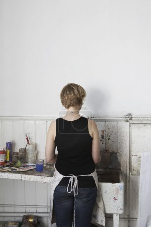 Female Artist near  sink