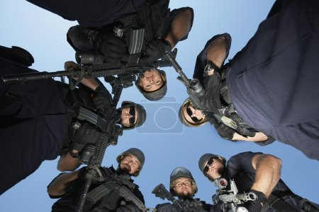 Swat officers standing in circle
