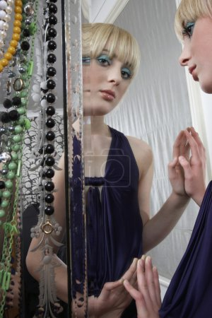 Girl reflected in mirror