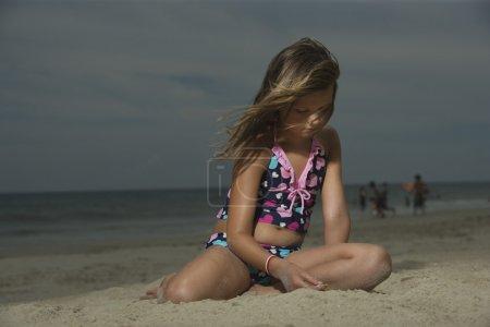 Girl Sitting on a Beach