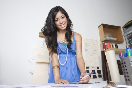 Designer working at desk