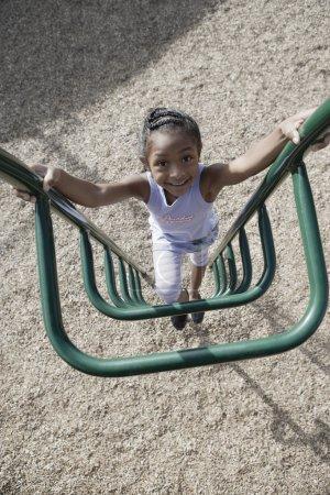 Girl climbing on playgroung