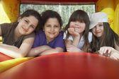 Girls lying in row in bouncy castle