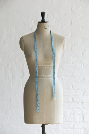Mannequin with measuring tape