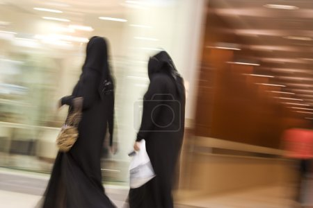 Women dressed in abayas and hijabs