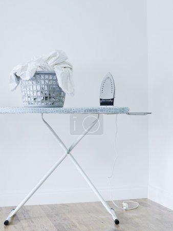 Iron and laundry basket