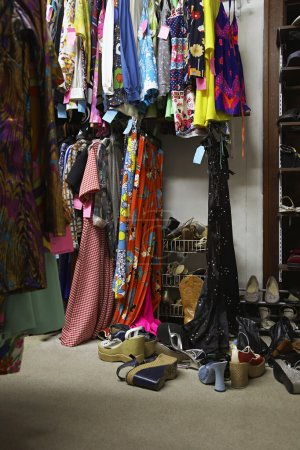 Photo for Crowded Clothing Racks and Piled Shoes in Second Hand Store - Royalty Free Image