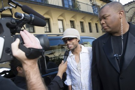 Male celebrity being interviewed