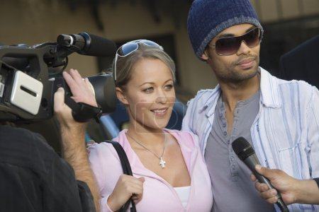 Photo for Celebrity couple being interviewed by the media - Royalty Free Image