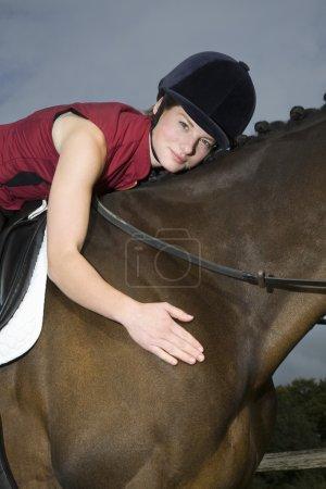 horseback rider hugging horse