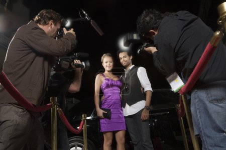 Female celebrity being photographed