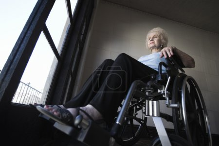 Photo for Senior Woman operating wheelchair - Royalty Free Image