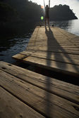human silhouette on jetty